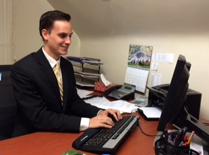Annual Giving officer Ben See looks over phonathon applications in his office.